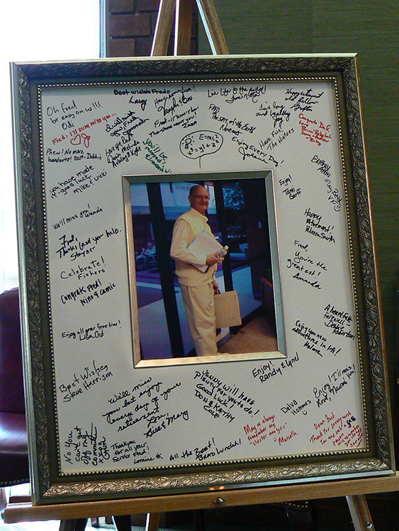 A framed photo of Dr. Fred Janzen with notes written around the picture