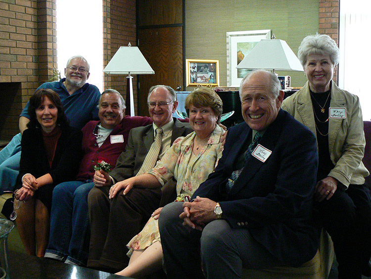 Dr. Fred Janzen and his wife, surrounded by social work faculty
